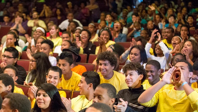Shortridge Magnet High School students cheer for math educator Tina Ahlgren on June 6, 2014, as she is named the Indianapolis Public Schools Teacher of the Year.