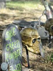 Tombstones and skulls line a yard on East Fifth Street