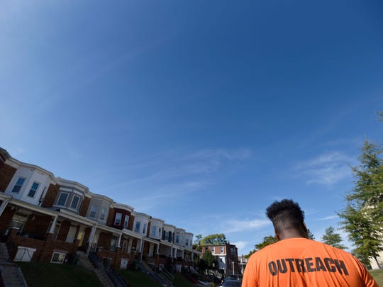 Paul Frazier walks the streets regularly as part of his job as a violence interrupter for the Baltimore City Health Department's Safe Streets program, in Baltimore's Park Heights section.