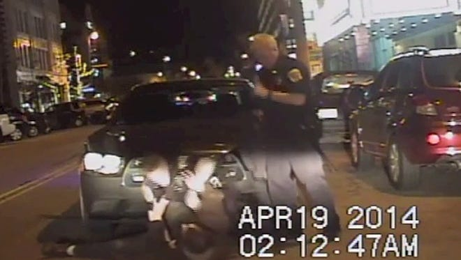 A dashboard camera from a Green Bay police car shows the scuffle between Officer Derrick Wicklund and Joshua Wenzel on April 19 on South Washington St.