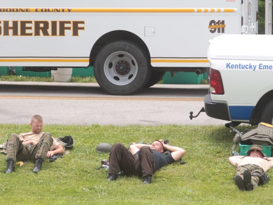 Boone County Sheriff's SWAT members who have been searching Big Bone Lick State Park for David Lee Rickerson rest after the Florence Police SWAT relieved them.  Boone County Sheriff's Major Bill Mark said a SWAT member is equipped with more than 50 pounds of equipment and the heat and rugged terrain are hard on them.