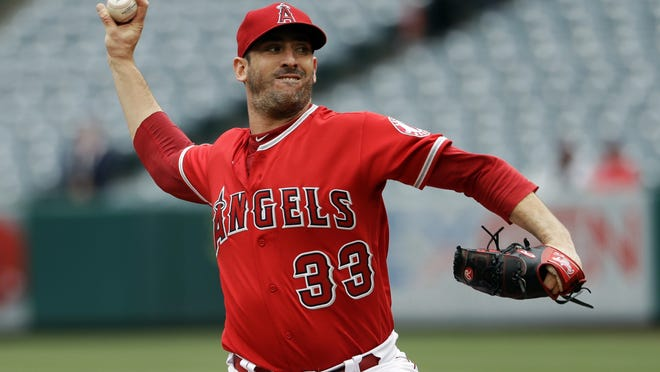 FILE - In this May 23, 2019, file photo, Los Angeles Angels starting pitcher Matt Harvey throws to the Minnesota Twins during the first inning of a baseball game in Anaheim, Calif.  The Kansas City Royals signed former All-Star Matt Harvey to a minor league contract, the team announced Tuesday, July 28, 2020.