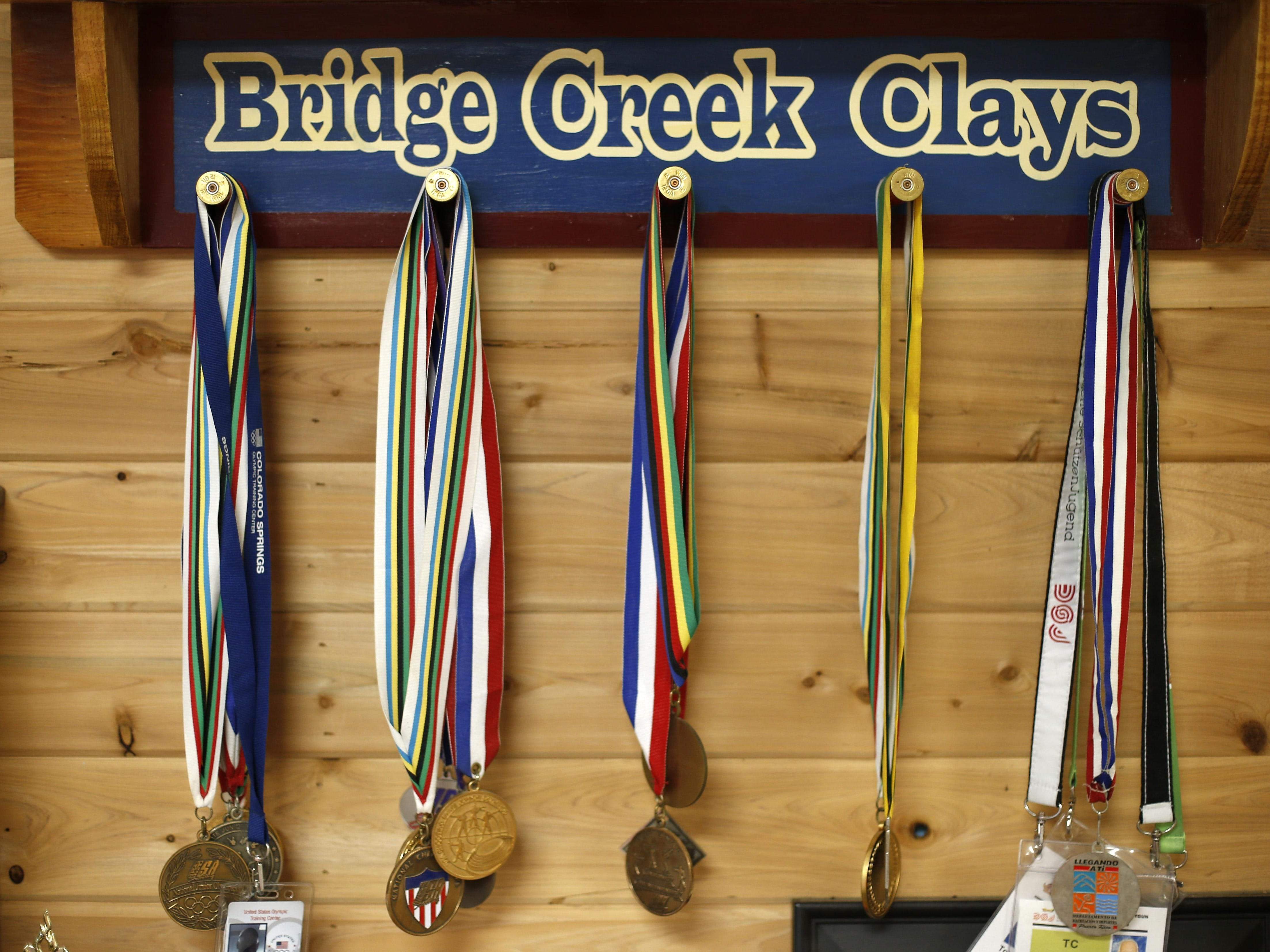 Medals hang on the wall at the Bridge Creek Clays South Georgia Youth Shooting Club on Tuesday, June 30, 2015.