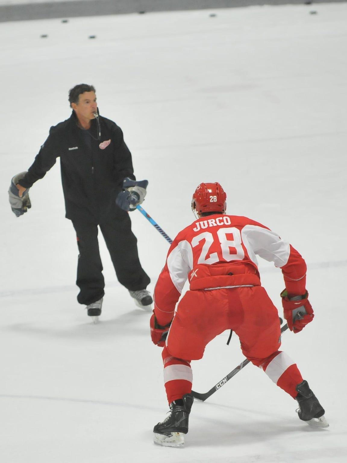 Cranbrook Kingswood's  veteran boys hockey head coach