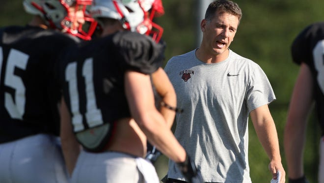 Brown University football coach James Perry at practice last season. The Ivy League is expected to announce on Wednesday the fate of fall sports.