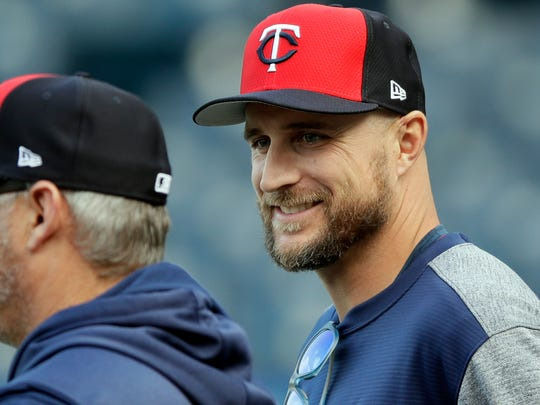 Minnesota Twins manager Rocco Baldelli smiles during batting practice before a baseball game against the Kansas City Royals at Kauffman Stadium in Kansas City, Mo., Tuesday, April 2, 2019. (AP Photo/Orlin Wagner)