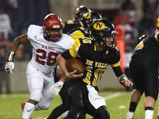 Tri-Valley's Andrew Newsom looks for room to run during