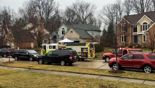 Five people died in a fire at a Novi, Mich., home on Sunday, Jan. 31, 2016. The fire started in the basement of the home with the firetruck in front of it.