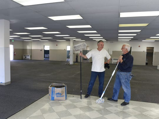 Ky Good, left, and Norm Smith take a break from cleaning up the new C4CUBE building in Midtown on Oct. 14, 2014. As an incubator, C4CUBE helps aspiring entrepreneurs launch their startups and provides support to help them grow their business.