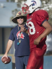 Strathmore head football coach Jeromy Blackwell works with his players during a practice in October.