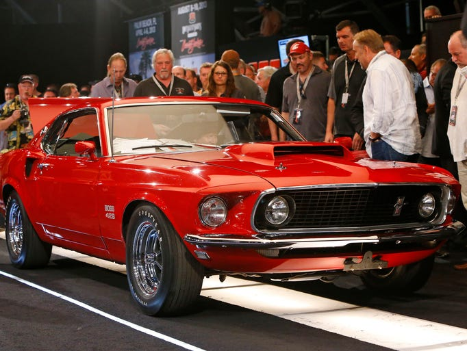 A 1969 Ford Mustang Boss 429 Fastback rolls across