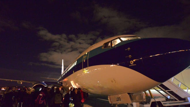 The charter jet, a Boeing 737-800, dubbed 'Bernie Express,' sits on the tarmac at Manchester airport in New Hampshire. The plane carried Bernie Sanders and journalists from Iowa to New Hamsphire after the Iowa caucus, landing at 4:10 a.m. on Feb. 2, 2016.