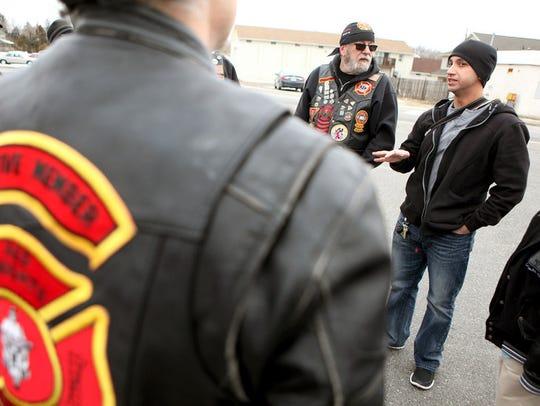 U.S. Army Staff Sergeant Ryan Cotto, right, a Vineland