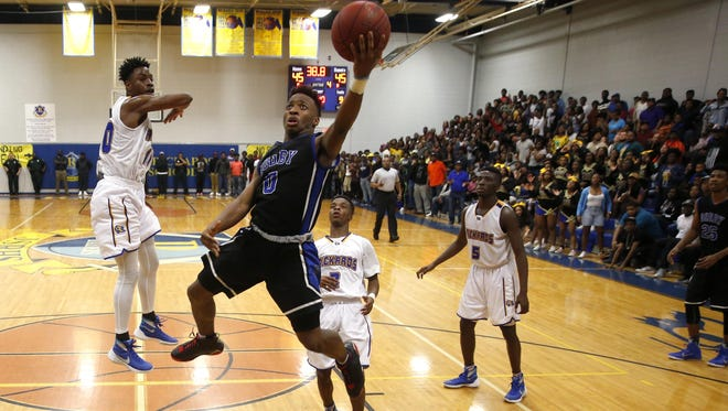 Godby's B.J. Gant makes a tying layup in the final minute against Rickards during a 49-47 win in the Region 1-5A semifinal.