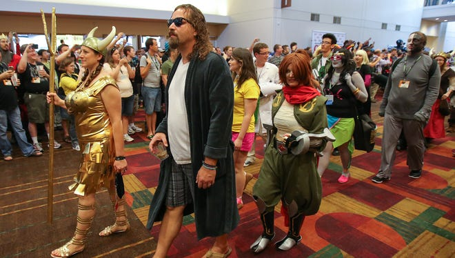 """The costume parade at the 2014 edition of Gen Con included portrayals of Maude Lebowski and """"The Dude"""" from """"The Big Lebowski."""""""