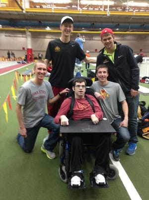 Members of Iowa State's track team surround Andy Ackermann at an indoor track race this season. Pictured from left: Jason Thomas, Brian Biekert, Josh Evans and Keegan Hurley.