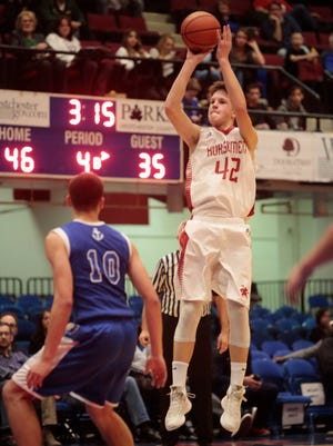 Sleepy Hollow's Andrew Laub (42) shoots in the fourth quarter during his team's 52-36 win over Hen Hud in a challenge game of the Slam Dunk Tournament at the Westchester County Center on Dec. 27, 2015.