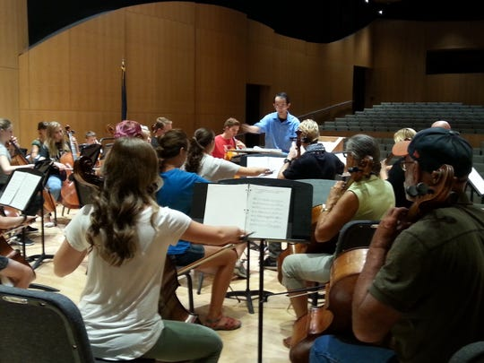 Dixie State University Cello Festival Director Ka-Wai Yu, center,  leads a practice session.