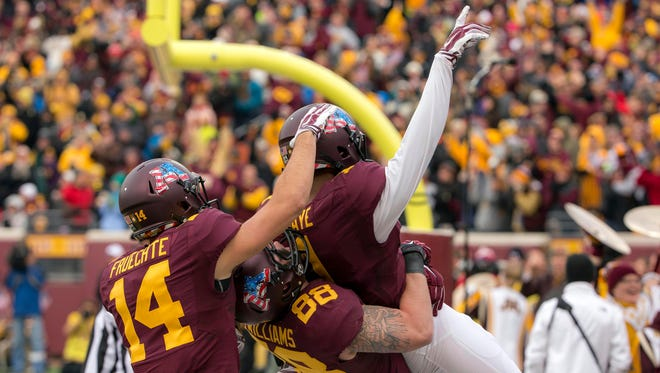 Minnesota wide receiver KJ Maye (1) celebrates with tight end Maxx Williams (88) and Gophers wide receiver Isaac Fruechte (14) after scoring a touchdown in the first half in a 51-14 win against Iowa.