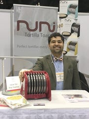 Elliot Benitez displays the NUNI tortilla toaster.