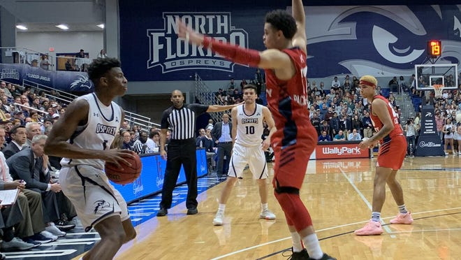 Dorian James of the University of North Florida looks for an opening to pass last year in a victory over Liberty at UNF Arena.