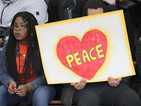 Students at Lincoln High School in Yonkers, join in