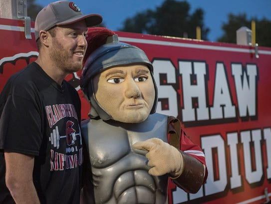 Tim Shaw and the Clarenceville Trojan mascot pose for