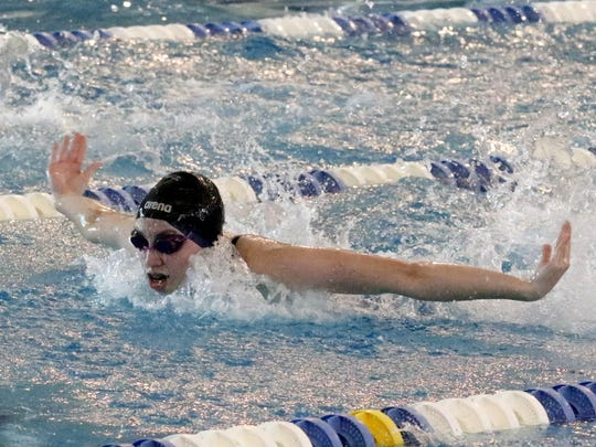 Katie Shoen of Owego swims in the 100-yard butterfly preliminaries Friday at the New York State Girls Swimming and Diving Championships at Ithaca College.