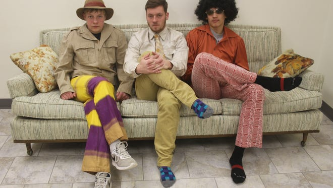 Male models -- from left, Kaleb Sternhagen, Chase Sternhagen and Will Bayer -- show off fashions from the 1960s and 1970s to be modeled during the Victor United Methodist Church's annual Vintage Style Show and Tea Party.