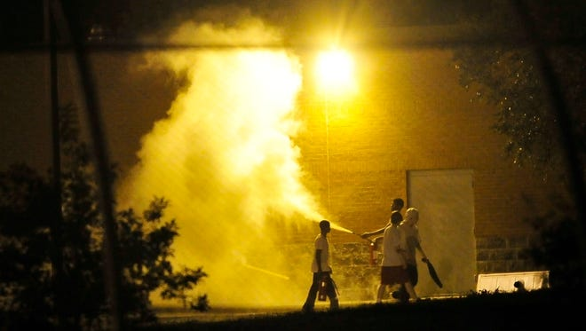 Teenagers spray a fire extinguisher on Sept. 4 at Woodland Hills Youth Development Center. DCS' attempts to defuse the situation have seen only temporary results, and the youths at WHYDC seem to have become emboldened by their recent breakouts.