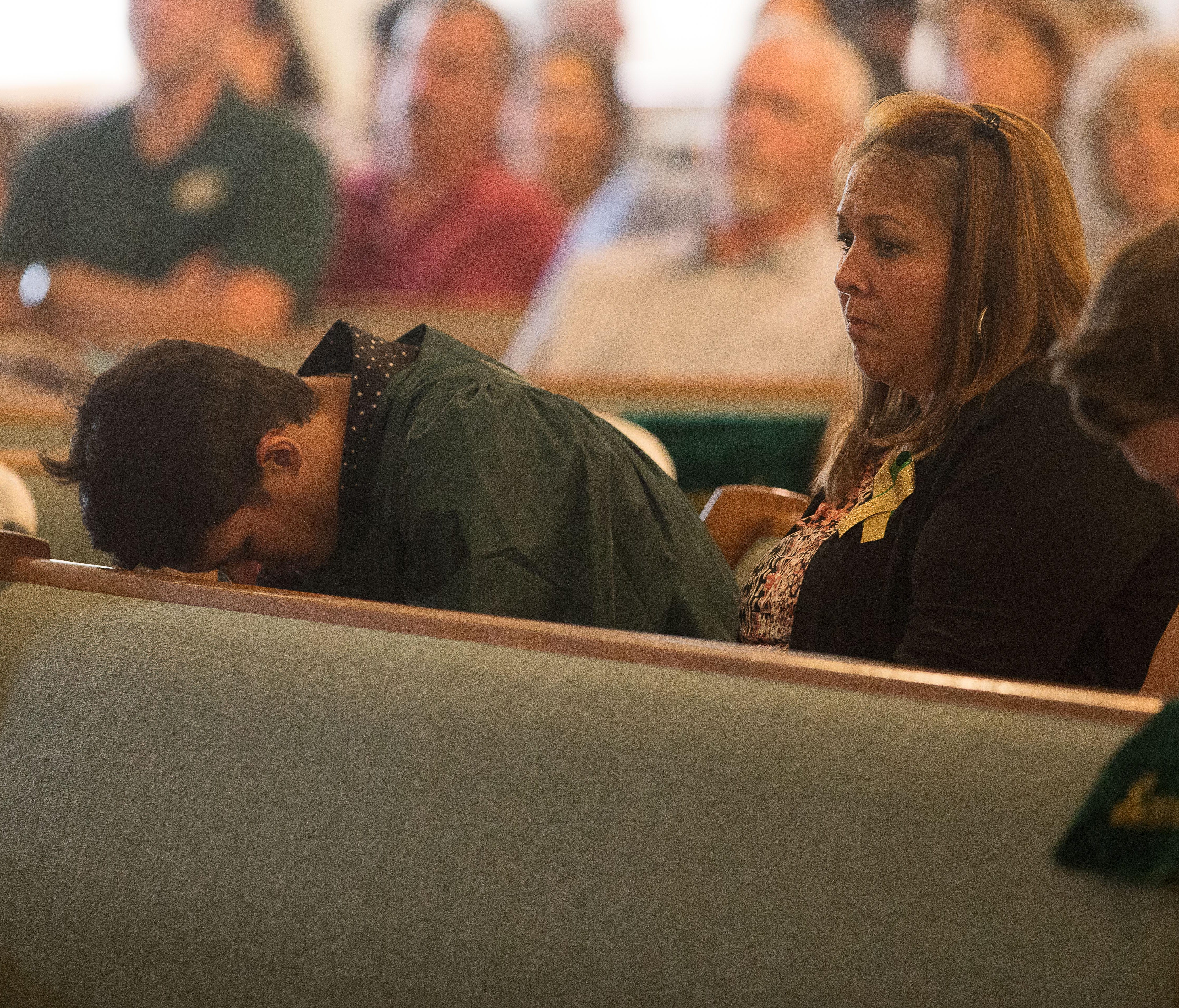 A Santa Fe High School senior becomes emotional during a service at Arcadia First Baptist Church in Santa Fe, Texas on May 20, 2018.