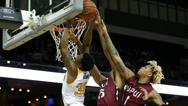 Northern Kentucky Norse guard Lavone Holland II (30) is blocked at the rim by IUPUI Jaguars guard Ron Patterson (25) in the first half during the college basketball game between the IUPUI Jaguars and the Northern Kentucky Norse, Thursday, Dec. 28, 2017, at BB&T Arena in Highland Heights, Ky.