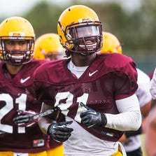 Arizona State wide receivers Jaelen Strong (left) and Gary Chambers run drills at practice on Tuesday, Aug. 12, 2014.