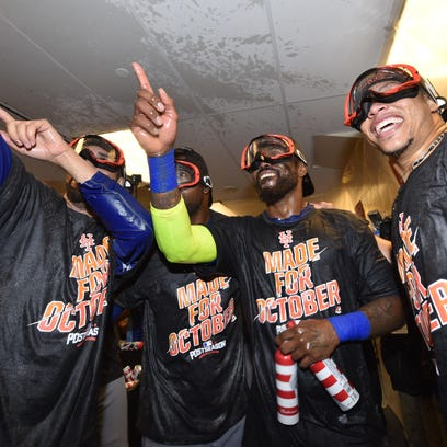 The New York Mets celebrate in the clubhouse after