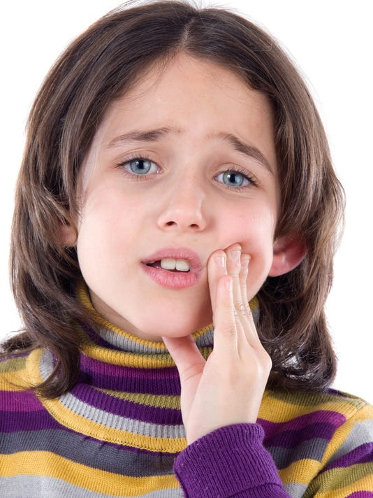 Adorable girl whit toothache