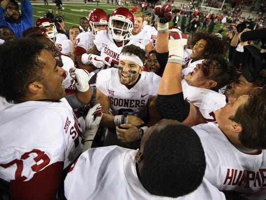 Oklahoma quarterback Baker Mayfield celebrates with