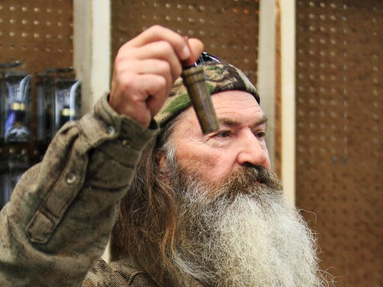 "File-This Nov. 7, 2013 file photo shows Phil Robertson, the Duck Commander, holding the 1 millionth duck call assembled for 2013 at company?s warehouse in West Monroe, La. The A&E channel says ""Duck Dynasty"" patriarch Robertson is off the show indefinitely after condemning gays as sinners in a magazine interview. In a statement Wednesday,  Dec. 18, 2013, A&E said it was extremely disappointed to read Robertson's comments in GQ magazine. (AP Photo, The News-Star/Margaret Croft)     NO SALES"