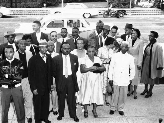 Inter-Civic Council leaders wait outside City Hall in Tallahassee, Fla. on Oct. 17, 1956 for the start of their trial on charges of operating illegal car pool to transport  African Americans  boycotting buses in segregated seating protest. Rev. C.K. Steele, council President, is second from left in front row.