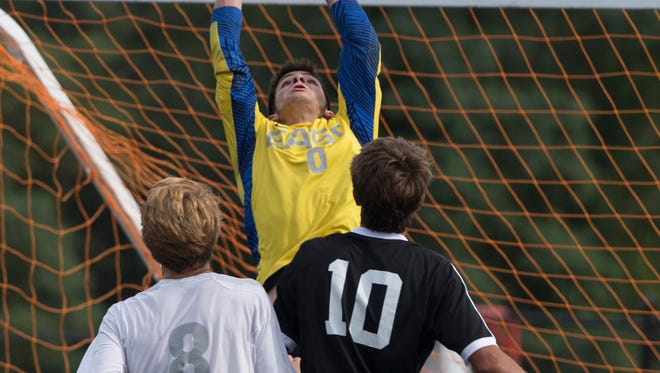 Toms River East goalie Steve Cosentino pulls in a ball in front of goal during Jackson Memorial boys soccer vs Toms River East in Toms River, NJ on September 20, 2016.