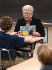 In this file photo, Joan Caggiano, owner of Nicola's Pizza in Rehoboth, reads to fourth-graders at Rehoboth Elementary School Tuesday Nov. 13, 2007.