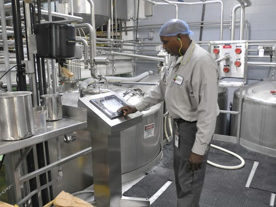 Eddie Kelly works at Whitfield Foods in 2012.