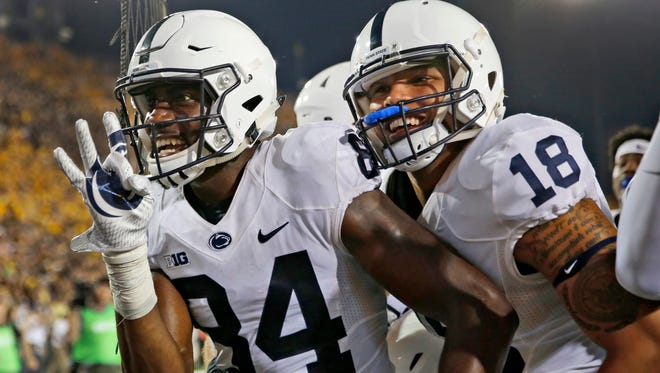 Juwan Johnson, left, celebrates in front of the Iowa crowd with teammate Jonathan Holland after making his walk-off touchdown catch. It was the first TD catch of his Penn State career.