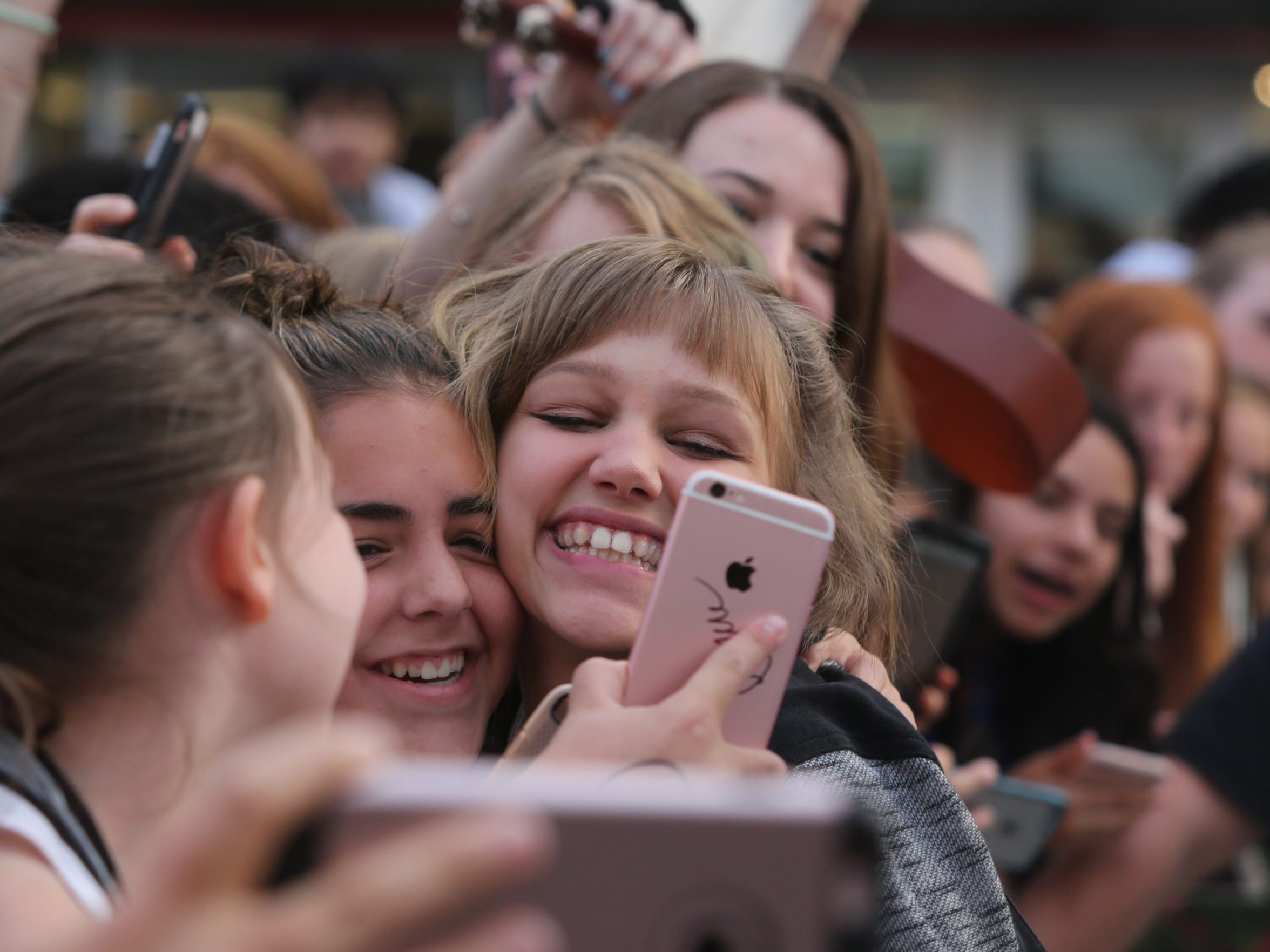 Grace VanderWaal greets her fans after performing during