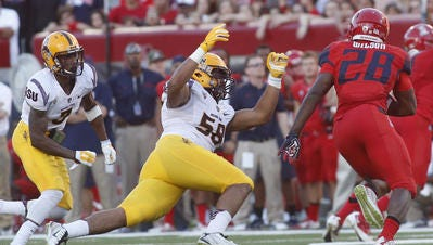 Arizona's Nick Wilson ran for 178 yards and three touchdowns in a 42-35 win over ASU in the 2014 Territorial Cup.
