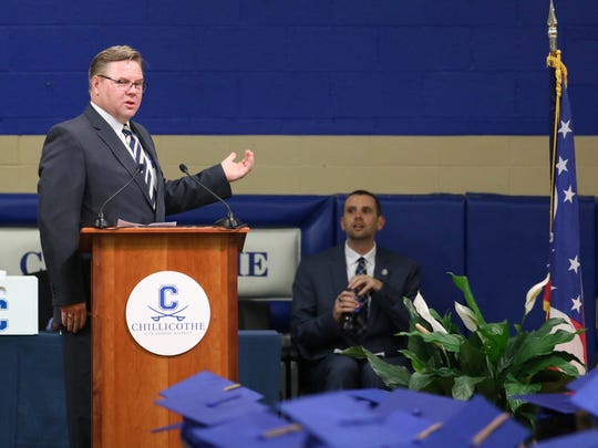 Jeff Fisher watches as Chillicothe City Schools Superintendent Jon Saxton speaks during the 2017 CHS graduation.