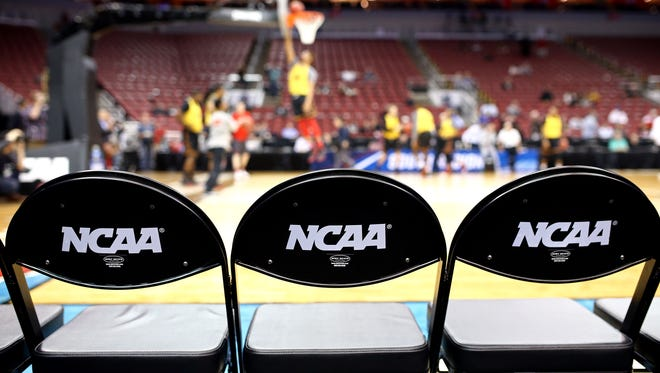 A view of the bench seats during practice the day before the semifinals of the South regional of the NCAA Tournament at KFC YUM!
