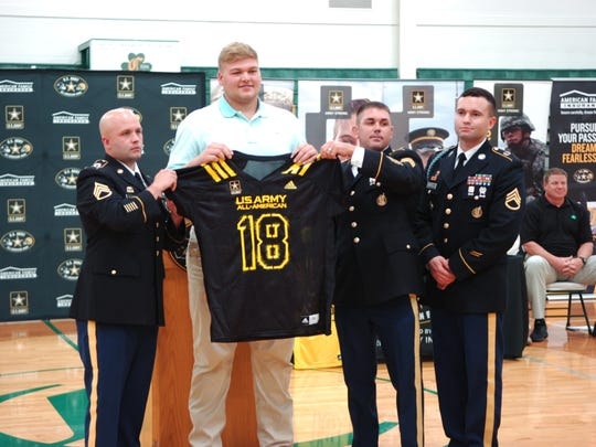 Cade Mays poses with members of the U.S. Army on hand for his All-American jersey presentation at Knoxville Catholic on Oct. 5, 2017.