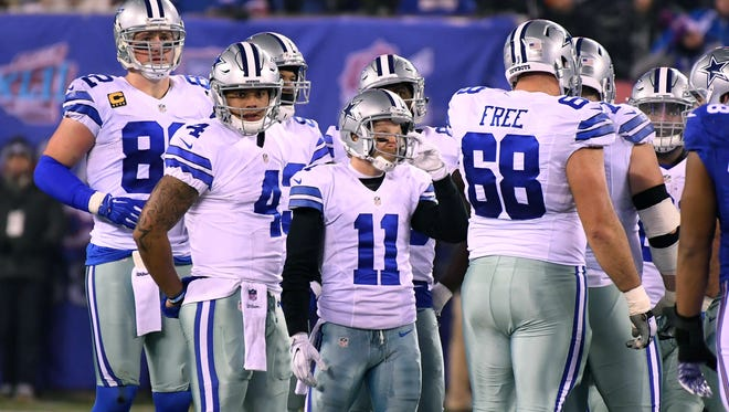 Dallas Cowboys wide receiver Cole Beasley (11), the shortest player in the huddle, in the 1st half at MetLife Stadium.