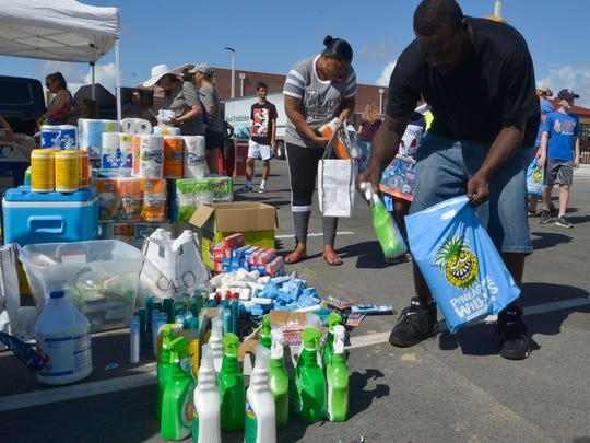 Panama City resident Thaddeus Evans pick up donated supplies from the Pensacola High School football team at the Tommy Oliver Stadium on Saturday, Oct. 20, 2018. Billed as a community gathering, the free football game between PHS and Mosley offered those in the hurricane disaster area a chance to relax and decompress from the storm's aftermath. (Photo: Tony Giberson/Pensacola News Journal)