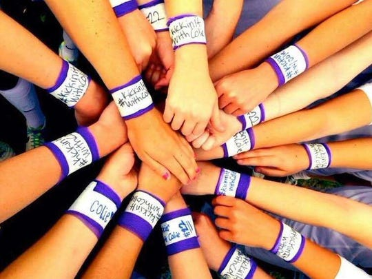 Elon women's soccer players taped their wrists to honor